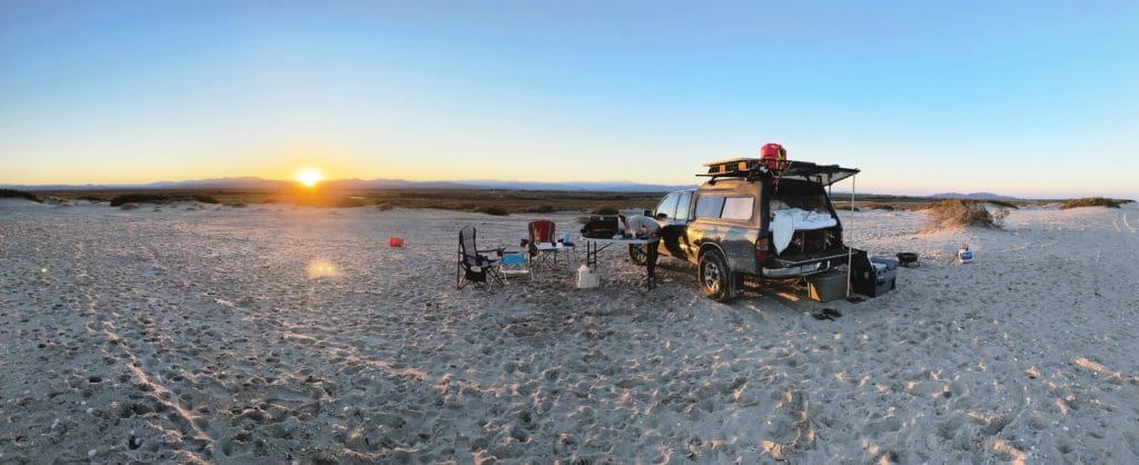 sunset with truck setup for camping